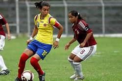 chicas jugando al futbol